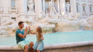 Family in Europe. Happy father and little adorable girl near Fontana di Trevi in Stock Footage