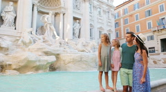 Family near Fontana di Trevi, Rome, Italy. Happy parents and kids enjoy italian Stock Footage