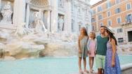 Family near Fontana di Trevi, Rome, Italy. Happy parents and kids enjoy italian Stock Footage
