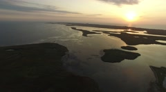 Flying over sea coast with fishing village Stock Footage