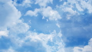 Time lapse clip of white fluffy clouds over sky Stock Footage
