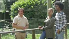 4K Keeper talking to a couple at bird conservation center. Stock Footage