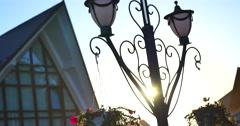Sun through the street lamp Stock Footage