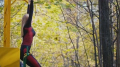 Young fitness female model Exercising in a Meadow at autumn park, Sports Outdoor Stock Footage