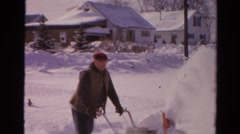 1954: 2 older men clearing snow from driveway after winter storm NEW YORK Stock Footage