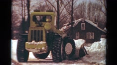 1954: snow tractor clean push away drag piles covered road clean NEW YORK Stock Footage