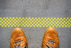 Start a new career concept with man feet at start line Kuvituskuvat