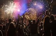 New Year concept - cheering crowd and fireworks Stock Photos