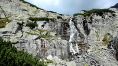 Pan camera move view of Skok waterfall near Strbske Stock Footage