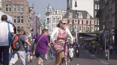 People on bikes at busy street in Amsterdam old city center. 4K Stock Footage