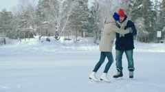 Boyfriend Teaching Girlfriend to Ice Skate Stock Footage