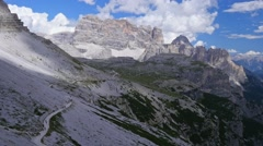 Clouds in the mountains. Dolomites, Italy. Tre Cime Stock Footage