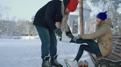 Cute Couple Getting Ready to Ice Skate Stock Footage