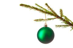 Decoration bauble on decorated Christmas tree iso Stock Photos