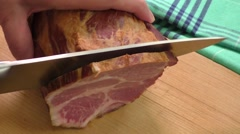 Carved ham on a wooden board Stock Footage