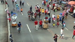 Ondel Ondel in Jakarta street on Sunday morning car free day Stock Footage