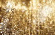 Abstract holiday background - fireworks at New Year and copy space Stock Photos