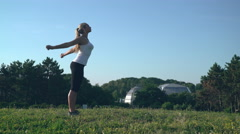Attractive female enjoy sport routine in the park Stock Footage
