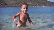 Happy kid bobbing in the sea Stock Footage
