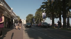 People and cars on the Croisette in Cannes, France Stock Footage