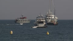 MOTOR YACHTS OFF CANNES, FRANCE Stock Footage