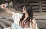Modern young woman in sunglasses Stock Photos