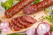 Slices of salami sausage Stock Photos