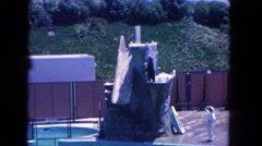 1962: a seal jumping into the pool in a water show with a large audience Stock Footage