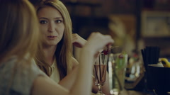 Women ignore man in a bar Stock Footage