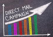 DIRECT MAIL CAMPAIGN written over colorful graph and rising arrow Stock Photos