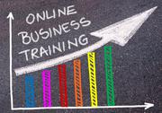 ONLINE BUSINESS TRAINING written over colorful graph and rising arrow Stock Photos