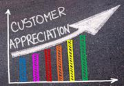 CUSTOMER APPRECIATION written over colorful graph and rising arrow Stock Photos