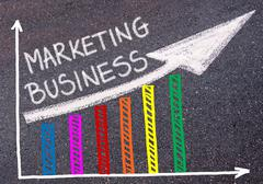 MARKETING BUSINESS written over colorful graph and rising arrow Stock Photos