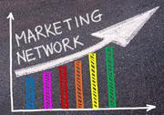 MARKETING NETWORK written over colorful graph and rising arrow Stock Photos