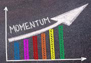 Momentum written over colorful graph and rising arrow Stock Photos