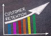Customer Retention written over colorful graph and rising arrow Stock Photos