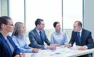 Smiling business team at meeting Stock Photos