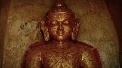 Ancient Buddha Statue Covered in Gold Leaf Stock Footage