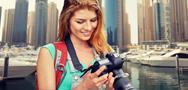 Woman with backpack and camera over dubai city Stock Photos