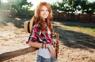 Cheerful woman cowgirl standing in village Stock Photos