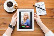 Close up of woman with tablet pc on wooden table Stock Photos
