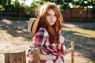 Attractive redhead young woman cowgirl standing outdoors Stock Photos