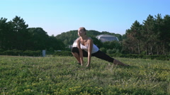 Smiling lady do exercises in forest Stock Footage