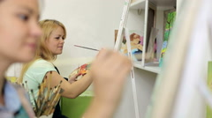 Two artists paint a picture in the art Studio, close-up. Stock Footage