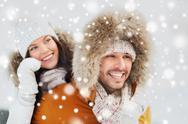 Happy couple having fun over winter background Stock Photos