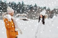 Happy couple playing snowballs in winter Stock Photos