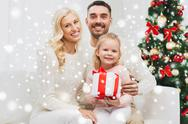 Happy family at home with christmas gift box Stock Photos