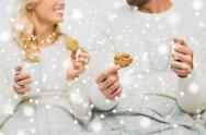 Close up of happy couple with cookies and tea cups Stock Photos