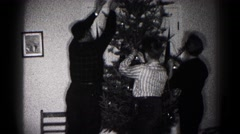 1959: christmas scene mother cheered indoor party presents many decorating Stock Footage