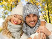 Happy couple in warm clothes over autumn Stock Photos